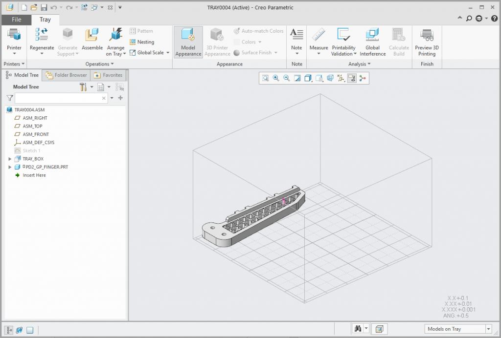Grafika przedstawiająca model umieszczony na tacy drukarki.
