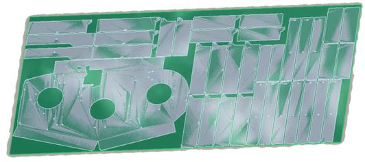 Grafika przedstawiająca rozmieszczenie elementów blaszanych do wycięcia z arkusza, przygotowane za pomocą rozszerzenia Creo NC Sheetmetal.